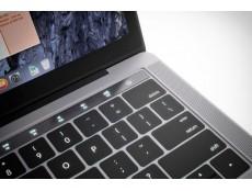 Фото Ожидается, что в новом ноутбуке Apple MacBook Pro в кнопку питания будет встроен сканер отпечатков пальцев Touch ID
